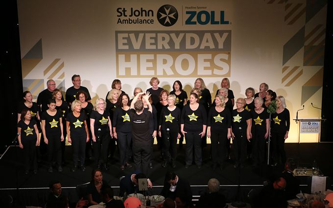 Rock choir singing on stage at Everyday Heroes awards evening.